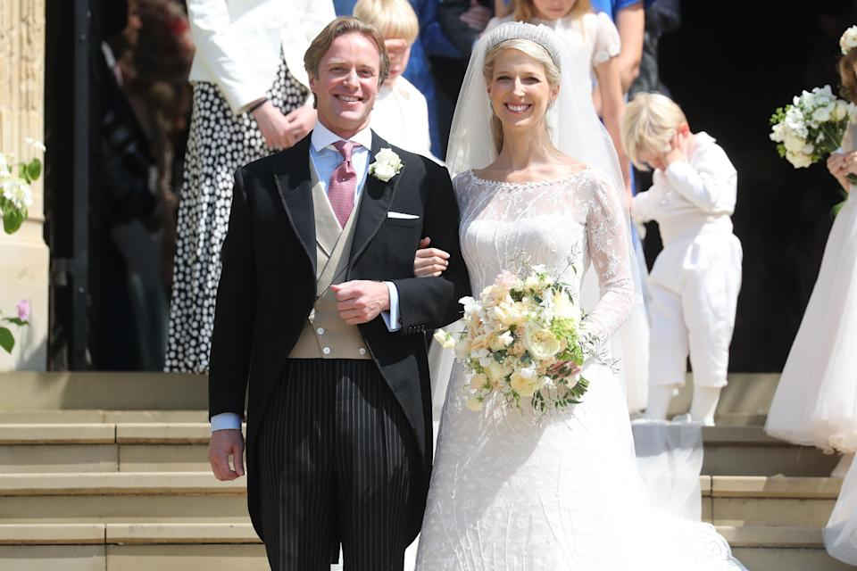 Newlyweds Mr Thomas Kingston and Lady Gabriella Windsor smile on the steps of the chapel after their wedding at St George's Chapel [Photo: Getty]
