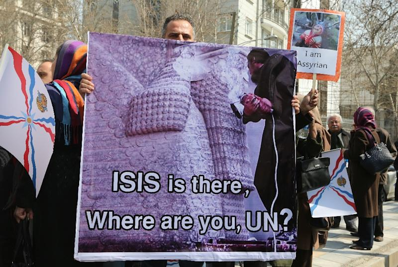 Iranian Assyrian Christians take part in a protest in front of the United Nations office in Tehran on March 12, 2015, to protest attacks on Assyrians in Iraq and Syria by the Islamic State (IS) group jihadists (AFP Photo/Atta Kenare)