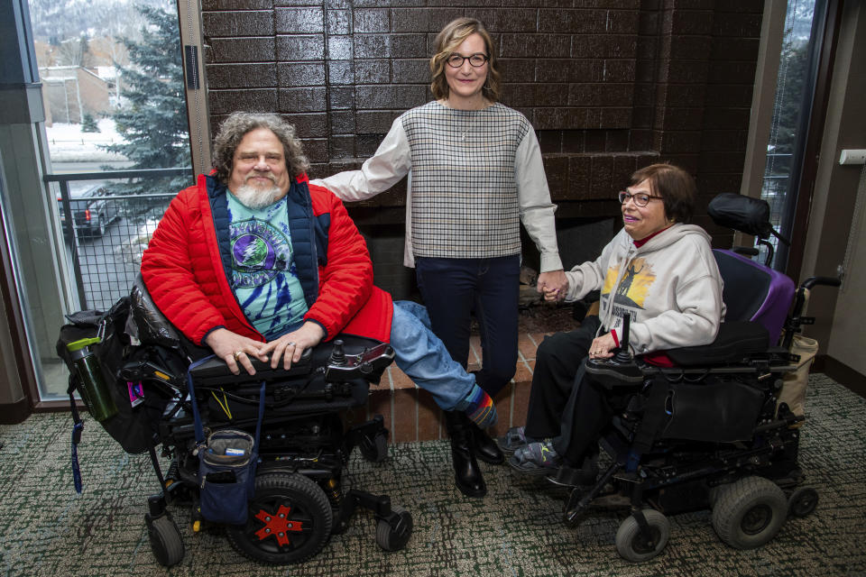"""FILE - In this Jan. 24, 2020 file photo, co-directors Jim LeBrecht, left, and Nicole Newnham, center, from the documentary """"Crip Camp"""" pose with film subject Judith Heumann during the Sundance Film Festival in Park City, Utah. The disabled have a moment in the Oscar spotlight that they hope becomes a movement. LeBrecht, who has spina bifida and uses a wheelchair, says a golden age for disabled films could come if Hollywood lets them tell their own stories. (Photo by Charles Sykes/Invision/AP, File)"""