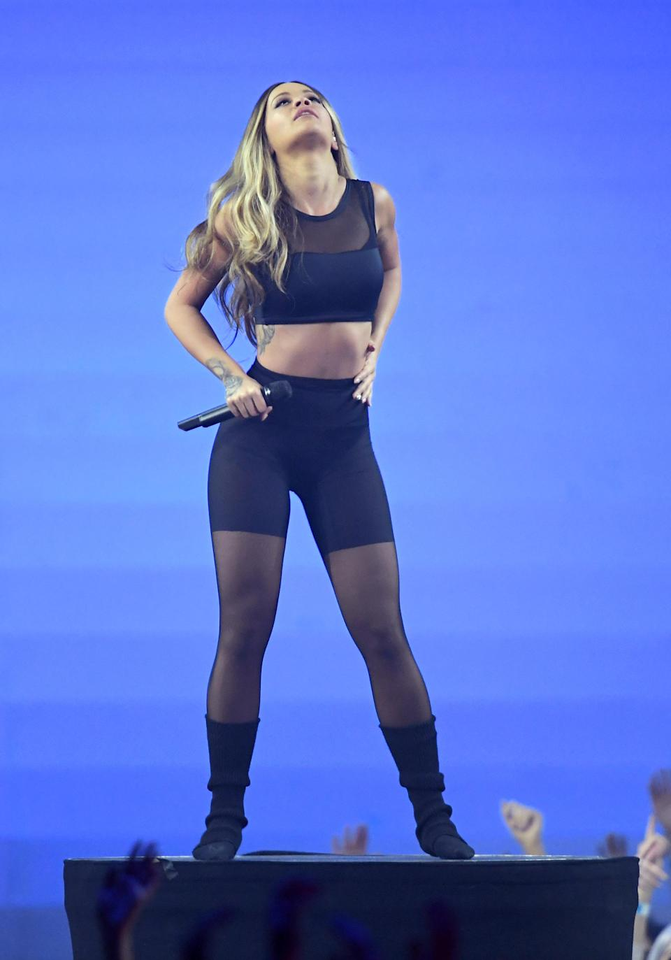 <p>The singer performed in a form-fitting cycling shorts and a mesh crop top. <em>[Photo: Getty]</em> </p>