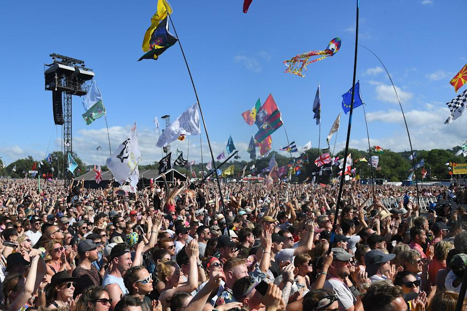 GLASTONBURY, ENGLAND - JUNE 30: The crowd watch Miley Cyrus performs on the Pyramid stage during day five of Glastonbury Festival at Worthy Farm, Pilton on June 30, 2019 in Glastonbury, England. (Photo by Dave J Hogan/Getty Images)