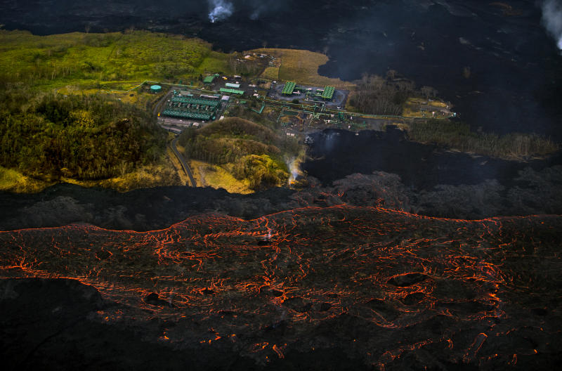 Lava from the Kilauea volcano flows near the Puna Geothermal Venture power plant on Sunday, June 10, 2018, in Pahoa, Hawaii. (AP Photo/L.E. Baskow)