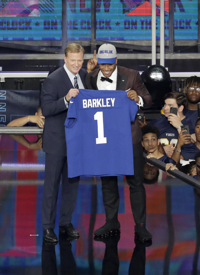 Penn State's Saquon Barkley, right, poses with commissioner Roger Goodell after being selected by the New York Giants during the first round of the NFL football draft, Thursday, April 26, 2018, in Arlington, Texas. (AP Photo/Eric Gay)