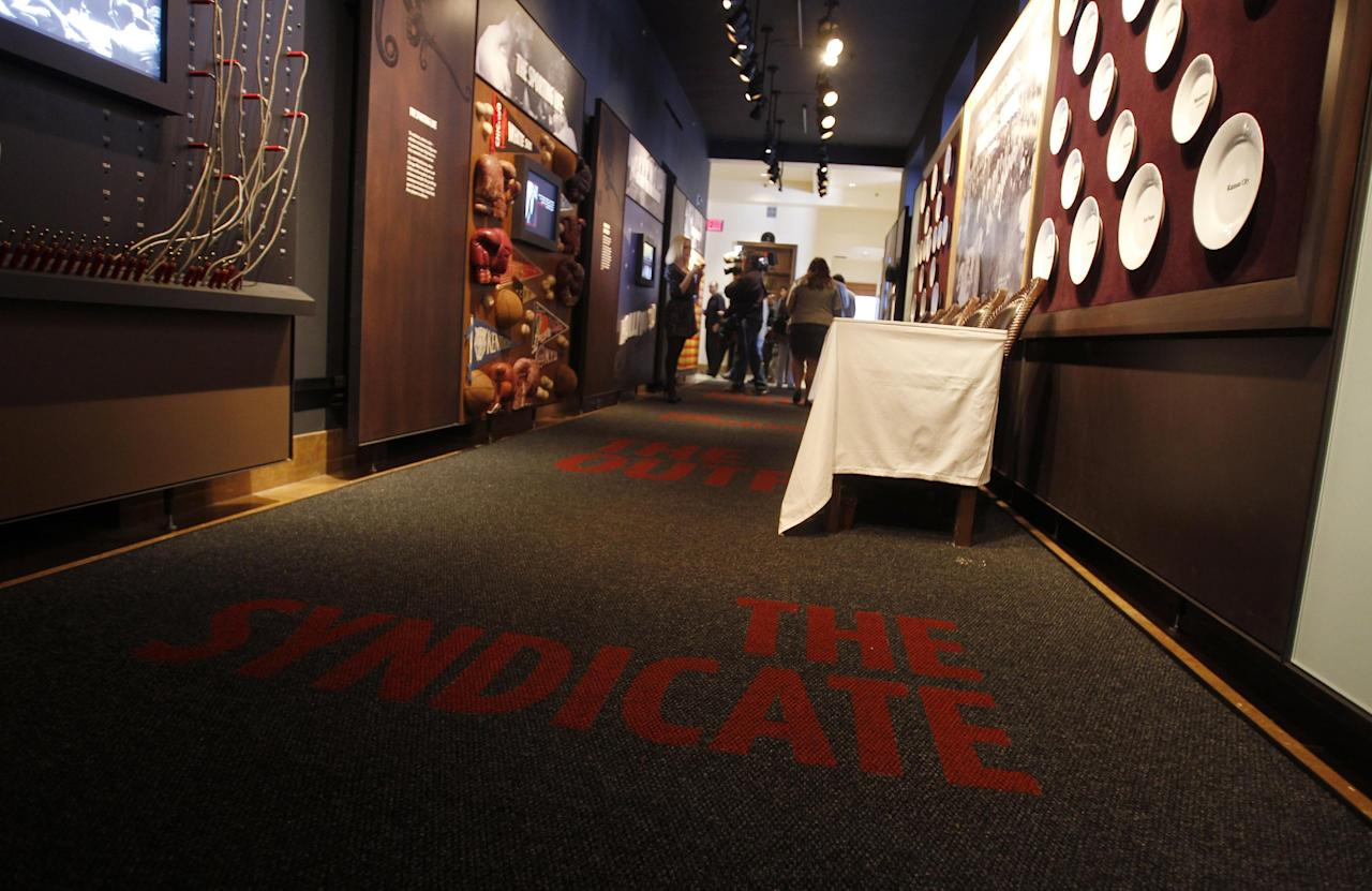 A carpet at The Mob Museum which features various organized crime groups is pictured Monday, Feb. 13, 2012, in Las Vegas. Las Vegas has long been enamored with its gangster roots. (AP Photo/Isaac Brekken)