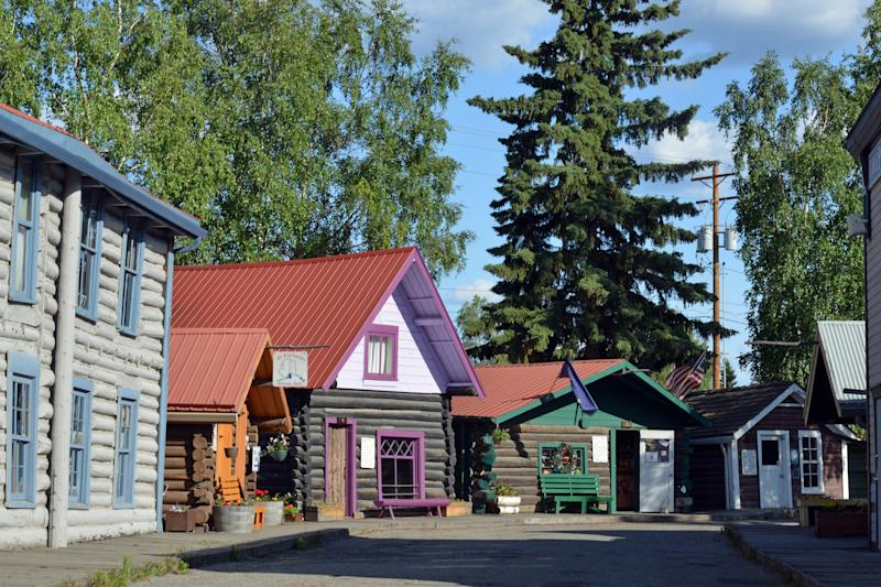 View of old, wooden Gold Rush Era houses put together in a public skansen Pioneer Park in Fairbanks, Alaska, USA.