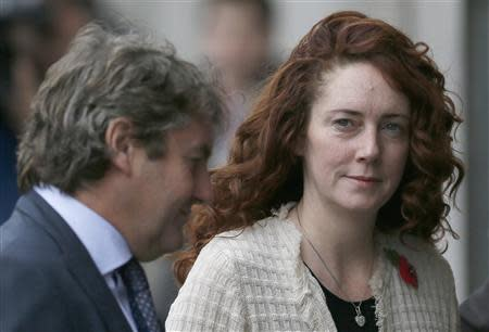 Former News International chief executive Rebekah Brooks and her husband Charlie arrive at the Old Bailey courthouse in London November 5, 2013. REUTERS/Stefan Wermuth