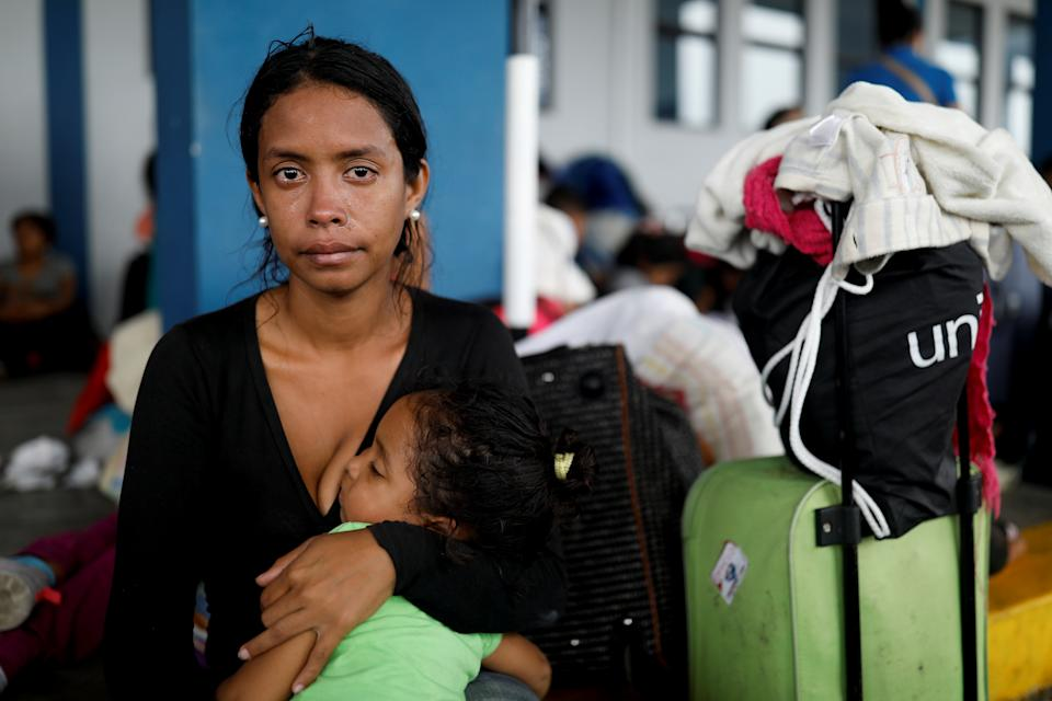 """Venezuelan migrant Marlioth Armas, 28, cries as she poses for a photo, while queueing with her daughter Erimar, 2, to process their documents at the Ecuadorian-Peruvian border service centre, before they continue their journey to Lima, on the outskirts of Tumbes, Peru, June 16, 2019. Armas cried in frustration describing the constant shortages of basic goods in Venezuela. """"Milk! Shampoo! Nothing!"""" said Armas, """"I just want to live somewhere we can get things and be normal."""" Describing the chaos of her journey she said: """"We crossed into Colombia walking along a pathway and crossing the river. The truth is, that I don't know why, since I had my border ID, I could have passed through the bridge, and there were people who had passport, I don't understand why we didn't cross by the bridge."""" REUTERS/Carlos Garcia Rawlins     SEARCH """"MOTHERS REFUGEE"""" FOR THIS STORY. SEARCH """"WIDER IMAGE"""" FOR ALL STORIES.   TPX IMAGES OF THE DAY"""