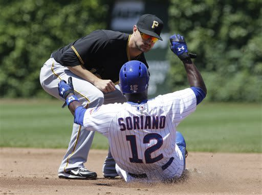 Pittsburgh Pirates shortstop Jordy Mercer, left, tags out Chicago Cubs' Alfonso Soriano at second base after Soriano was caught off first base during the second inning of a baseball game, Friday, June 7, 2013, in Chicago. (AP Photo/Nam Y. Huh)
