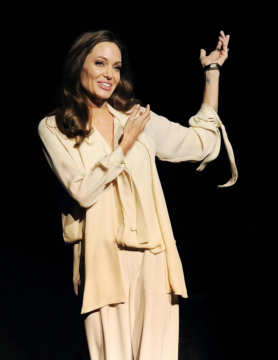 """Angelina Jolie, director of the upcoming film """"Unbroken,"""" introduces a trailer for the film during a surprise appearance onstage at a Universal Pictures studio presentation at CinemaCon 2014 on Tuesday, March 25, 2014 in Las Vegas. (Photo by Chris Pizzello/Invision/AP)"""
