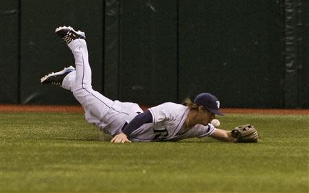 Tampa Bay Rays right fielder Myers comes up short as he dives for Texas Rangers' Andrus' single during their MLB American League baseball game in St. Petersburg