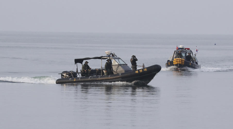 South Korean marine boats patrol near Yeonpyeong island, South Korea, Tuesday, Sept. 29, 2020. South Korea said Tuesday that a government official slain by North Korean sailors wanted to defect, concluding that the man, who had gambling debts, swam against unfavorable currents with the help of a life jacket and a floatation device and conveyed his intention of resettling in North Korea. (Kim Do-hoon/Yonhap via AP)