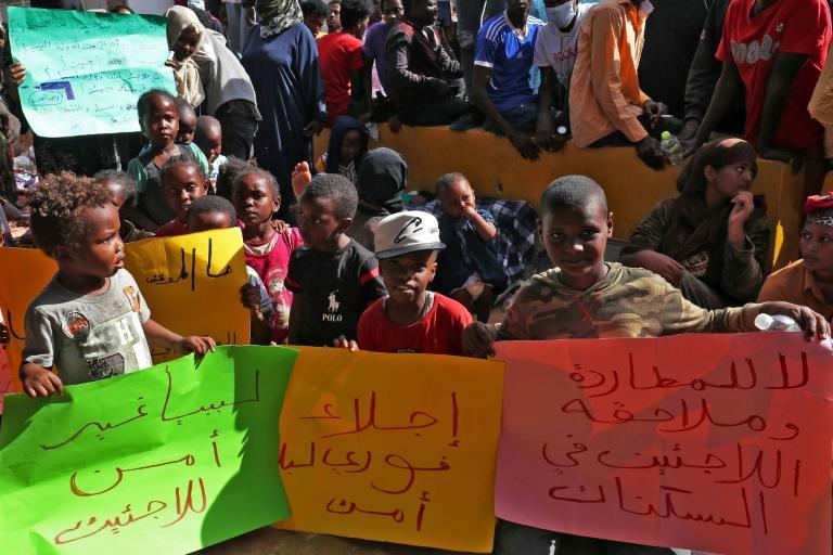 African migrants demonstrate outside the Tripoli office of the UN refugee agency demanding repatriation after Friday's shooting deaths again highlighted the appalling conditions they endure in Libya (AFP/Mahmud TURKIA)