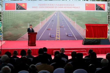 A general view shows Chinese President Xi Jinping (L) speaking during the opening ceremony of the China-Aid PNG Independence Boulevard Project ahead of the APEC summit in Port Moresby, Papua New Guinea, 16 November 2018.  Mast Irham/Pool via REUTERS