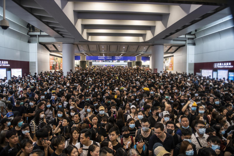 Protester are seen in Hong Kong International Airport in Hong Kong on August 12, 2019 , Tens of Thousands Protester are seen gather in Hong Kong international airport in protest of Police Brutally and the extradition bill -- Protester Clash with Police yesterday in Hong Kong -- Hong Kong International Airport suspended Flight Operation at at 15:45 Local Time Today. (Photo by Vernon Yuen/NurPhoto via Getty Images)