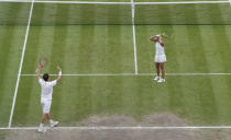 Britain's Neal Skupski, left, and Desirae Krawczyk of the U.S. celebrate after defeating Britain's Joe Salisbury and Harriet Dart during the mixed doubles final match on day thirteen of the Wimbledon Tennis Championships in London, Sunday, July 11, 2021. (AP Photo/Alberto Pezzali)