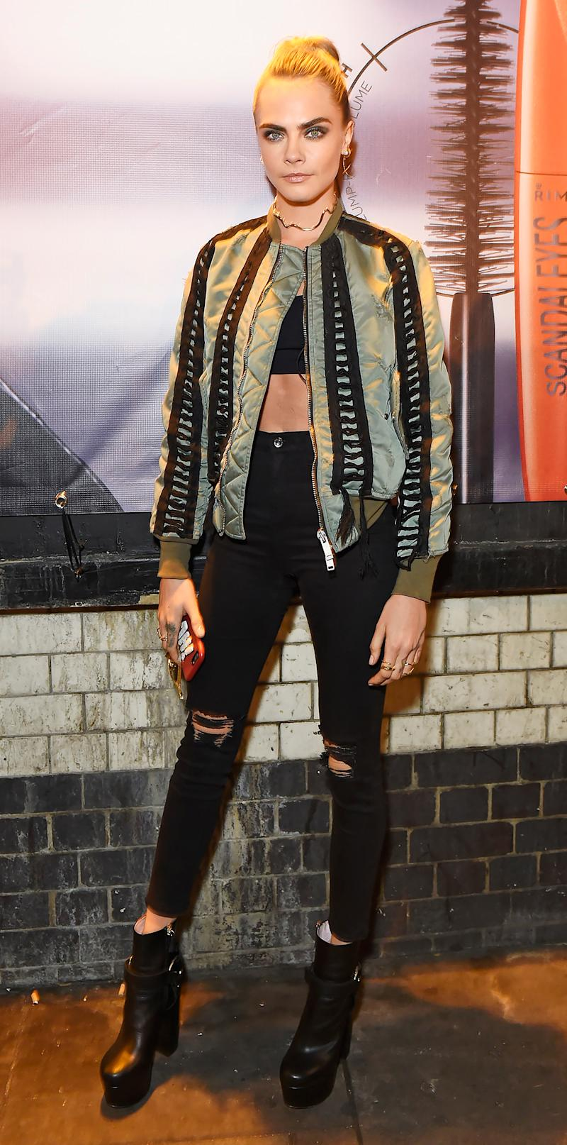 bdc605ed Cara Delevingne Flashes Her Abs in Bandeau Top and Edgy Bomber Jacket