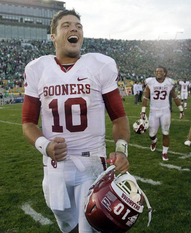 Oklahoma's Blake Bell (10) celebrates after defeating Notre Dame 35-21 in an NCAA college football game on Saturday, Sept. 28, 2013, in South Bend, Ind. (AP Photo/Darron Cummings)