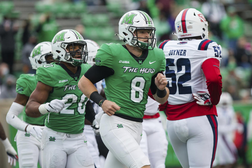 Marshall quarterback Grant Wells (8) and running back Brenden Knox (20) head to the sideline after a touchdown as the Herd takes on Florida Atlantic during an NCAA college football game at Joan C. Edwards Stadium, Saturday, Oct. 24, 2020, in Huntington, W.Va. (Sholten Singer/The Herald-Dispatch via AP)