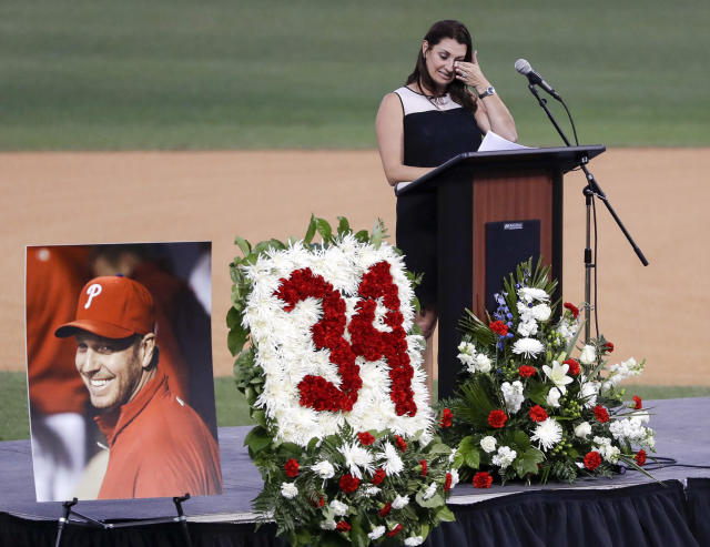 Brandy Halladay, wife of late pitcher Roy Halladay, wipes her eyes while talking about her husband during an event honoring his life (Yong Kim/The Philadelphia Inquirer via AP)
