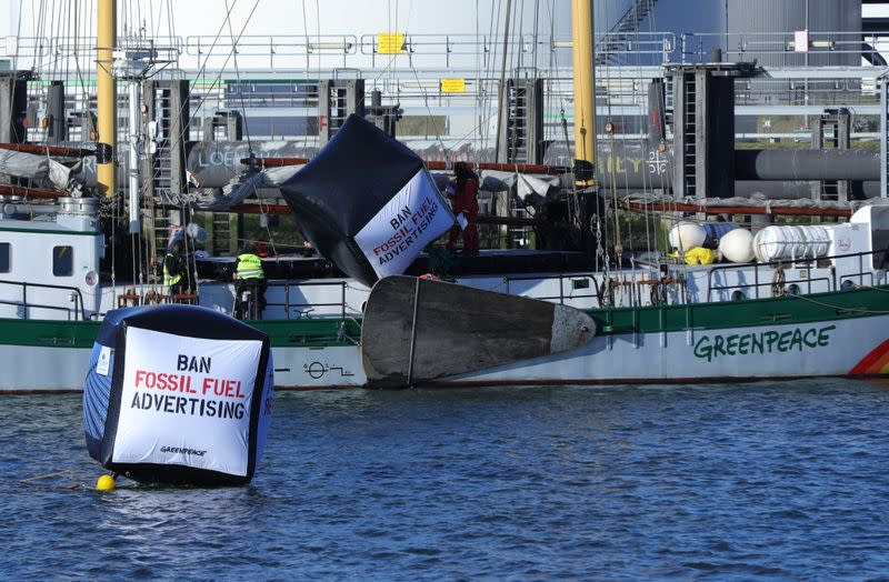 """Enviromental activist groups including Greenpeace protest against """"greenwashing"""" advertisements in Rotterdam"""