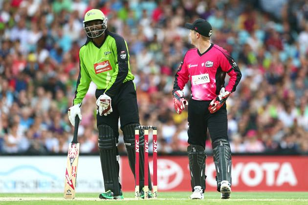 Chris Gayle of the Thunder and Brad Haddin of the Sixers share a laugh during the Big Bash League match between Sydney Thunder and the Sydney Sixers at ANZ Stadium on December 30, 2012 in Sydney, Australia.  (Photo by Mark Kolbe/Getty Images)