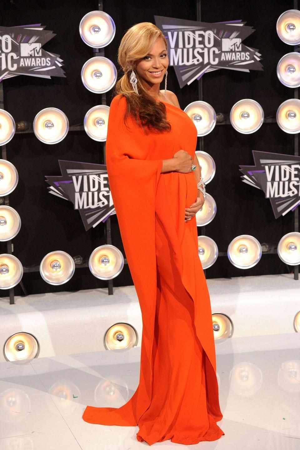 <p>Beyoncé takes the floor-length maternity trend to glamorous territory (naturally), opting for an orange one-shoulder gown that made her look like a brilliant Grecian goddess at the 2011 MTV Video Music Awards.</p>