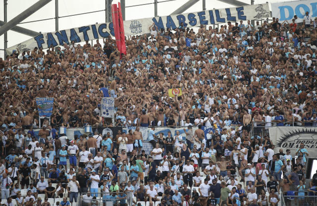 Marseille supporters gather in the stands before the French League One soccer match between Marseille and Reims at the Velodrome Stadium in Marseille, France, Saturday, Aug. 10, 2019. (AP Photo/Daniel Cole)
