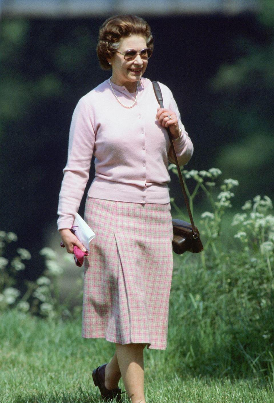 <p>Preppy style perfected: the casual day look the Queen walked the grounds of Windsor Castle in, in May, 1982.</p>