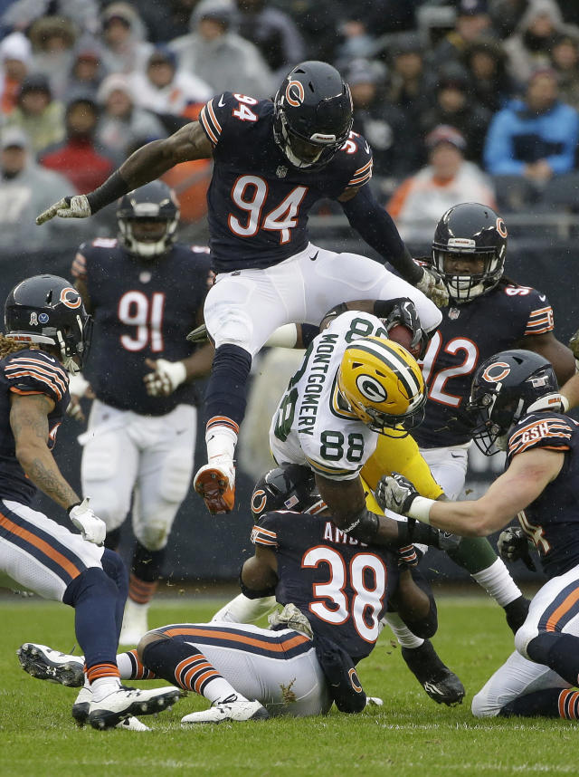 <p>Chicago Bears' Leonard Floyd (94) leaps over as the Bears strong safety Adrian Amos (38) tackles Green Bay Packers running back Ty Montgomery (88) during the first half of an NFL football game, Sunday, Nov. 12, 2017, in Chicago. (AP Photo/Nam Y. Huh) </p>