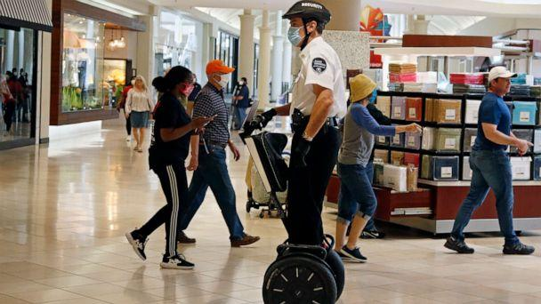 PHOTO: In this May 1, 2020 file photo, a security guard wearing a mask and riding a Segway patrols inside Penn Square Mall as the mall reopens in Oklahoma City. (Sue Ogrocki/AP, FILE)