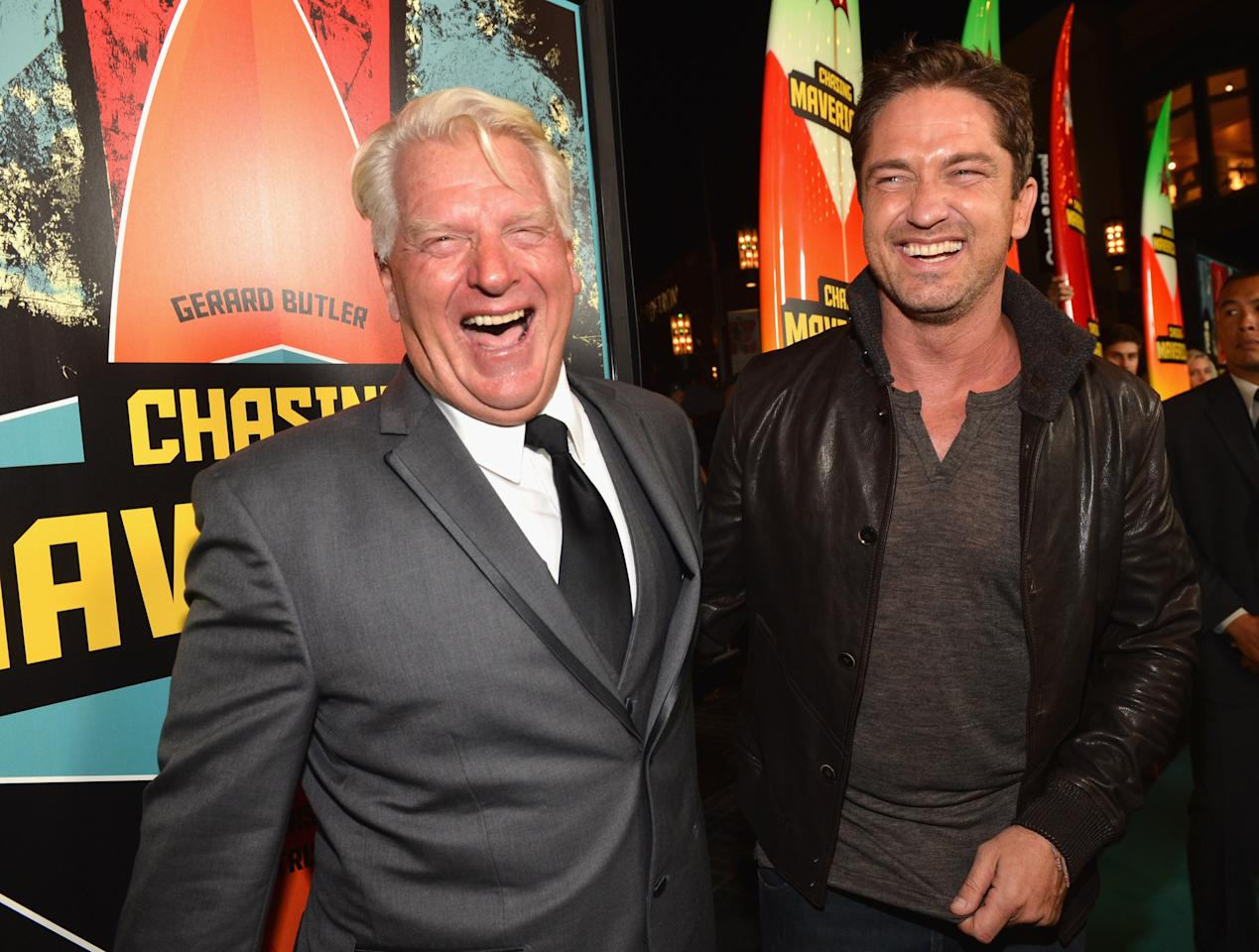 """LOS ANGELES, CA - OCTOBER 18:  Surfer Frosty Hesson and actor Gerard Butler arrive to the premiere of 20th Century Fox's """"Chasing Mavericks"""" on October 18, 2012 in Los Angeles, California.  (Photo by Alberto E. Rodriguez/Getty Images)"""