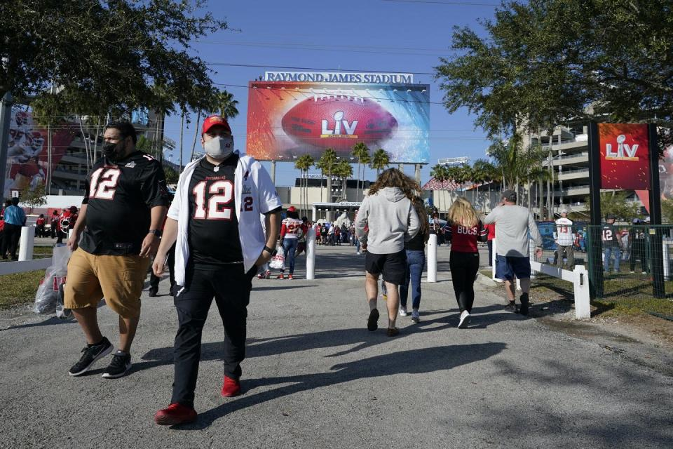 Fans arrive at Tampa's Raymond James Stadium for the Super Bowl on Feb. 7, 2021