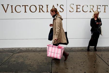 A customer passes by an L Brands Inc., Victoria's Secret retail store in Manhattan, New York