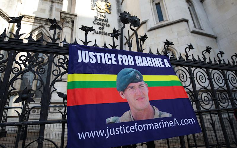 A banner in support of British Sergeant Alexander Blackman hangs from a fence outside the Royal Courts of Justice - 2017 Getty Images
