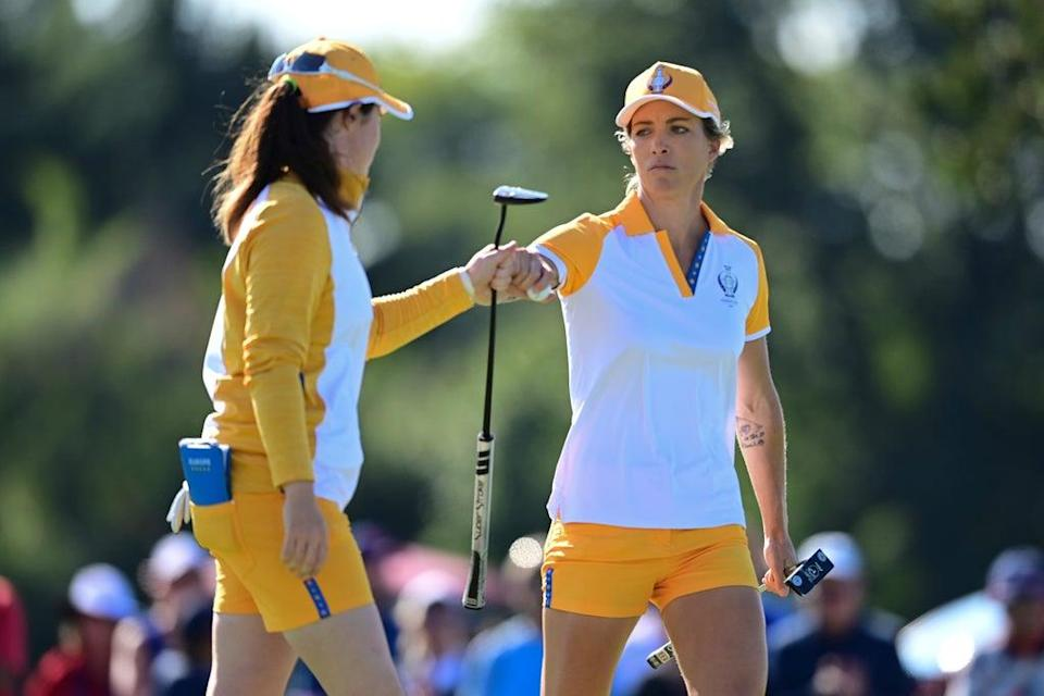 Europe's Mel Reid (right) and Leona Maguire celebrate after a putt on the 12th hole during the Solheim Cup (David Dermer/AP) (AP)