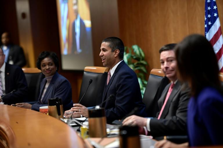 "FCC chairman Ajit Pai, center, speaks during a hearing ahead of a vote by the telecom regulator on ""net neutrality"" rules"