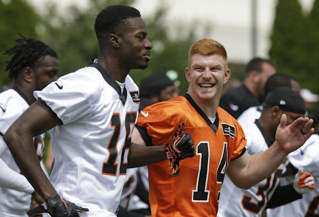 Cincinnati Bengals quarterback Andy Dalton (14) and wide receiver A.J. Green (18) run together during the NFL football team's first practice at training camp on Thursday, July 24, 2014, in Cincinnati. (AP Photo)