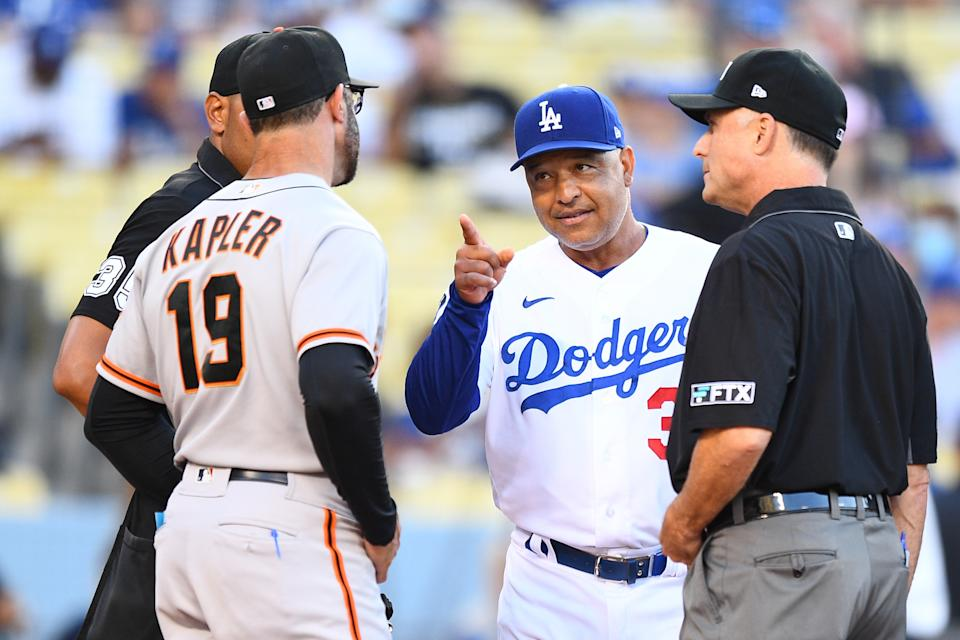 LOS ANGELES, CA - JULY 19: Los Angeles Dodgers manager Dave Roberts jokes with San Francisco Giants manager Gabe Kapler before a MLB game between the San Francisco Giants and the Los Angeles Dodgers on July 19, 2021 at Dodger Stadium in Los Angeles, CA. (Photo by Brian Rothmuller/Icon Sportswire via Getty Images)