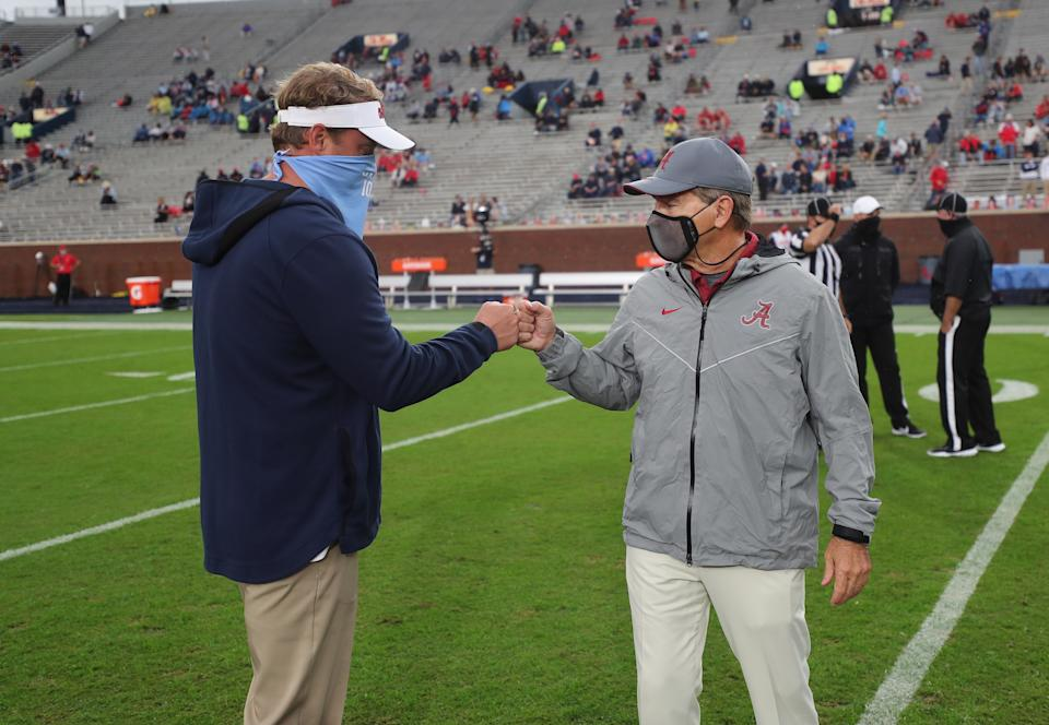 OXFORD, MS - OCTOBER 10: Head coach Nick Saban of the Alabama Crimson Tide meets head coach Lane Kiffin of the Ole Miss Rebels at Vaught Hemingway Stadium on October 10, 2020 in Oxford, Mississippi. (Photo by Kent Gidley/Collegiate Images/Getty Images)