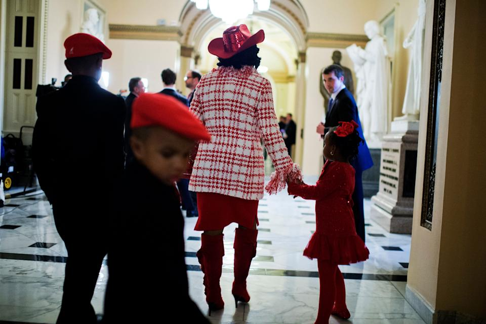Rep. Frederica Wilson (D-Fla.) walks with her family through the Will Rogers Hallway after the swearing-in of the 114th Congress on the House floor on Jan. 6, 2015.
