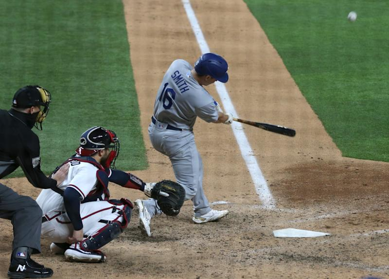 Dodgers catcher Will Smith hits a three-run home run in the sixth inning.