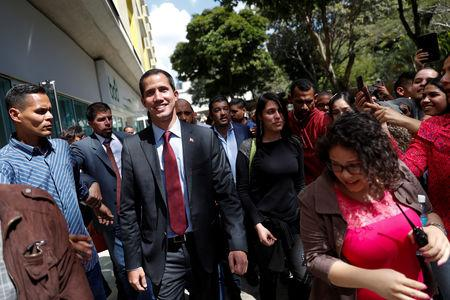 Venezuelan opposition leader Juan Guaido leaves after a meeting with representatives of FEDEAGRO, the Confederation of Associations of Agricultural Producers of Venezuela, in Caracas, Venezuela February 6, 2019. REUTERS/Carlos Garcia Rawlins