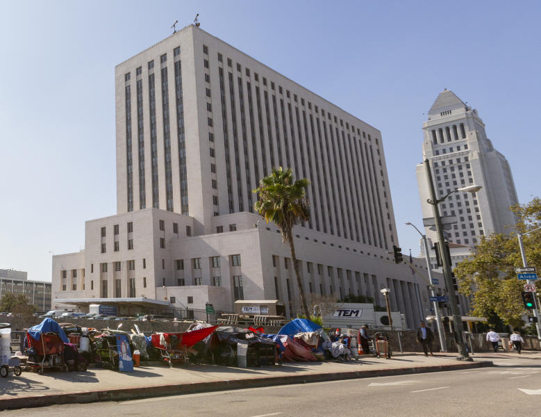 FILE - In this Sept. 17, 2019, file photo, shows a homeless camp in downtown Los Angeles. Los Angeles Police Chief Michel Moore said Wednesday, Jan. 15, 2020, at a news conference that in half of 2019's homeless homicide cases, the perpetrator was someone also believed to be experiencing homeless. (AP Photo/Damian Dovarganes, File)