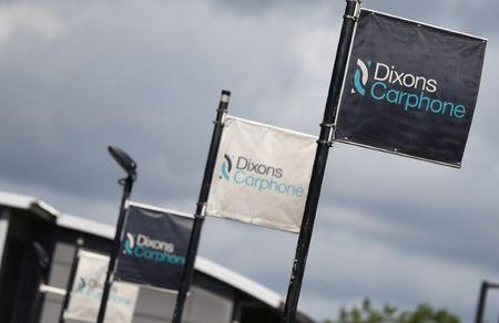 Signs display the logo of Dixons Carphone at the company headquarters in London