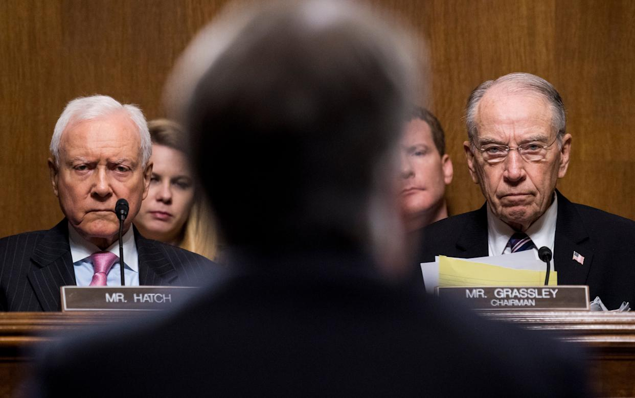 Sen. Orrin Hatch (R-Utah) and Sen. Chuck Grassley (R-Iowa) listen to Kavanaugh.