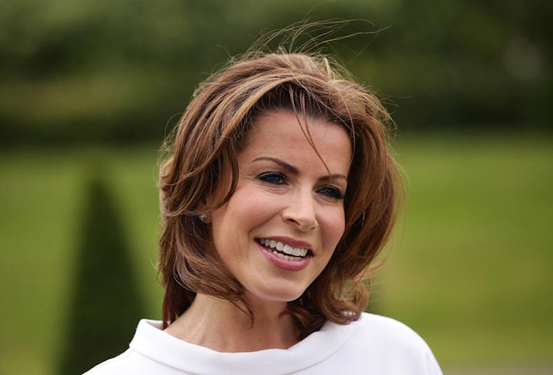 Natasha Kaplinsky, who has been awarded an OBE in the Queen's Birthday Honours List, outside Kensington Palace, London. (Photo by Yui Mok/PA Images via Getty Images)