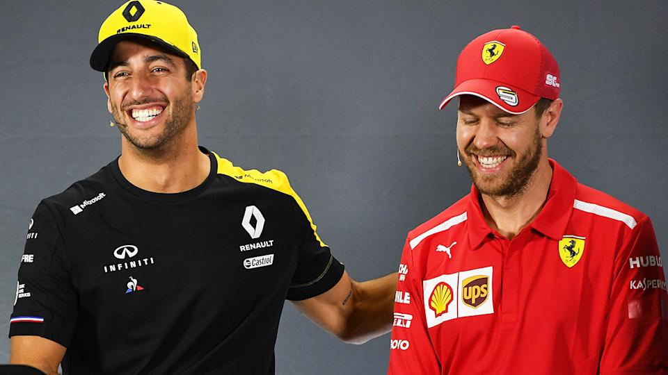 Daniel Ricciardo and Sebastian Vettel, pictured here speaking to the media at a press conference.