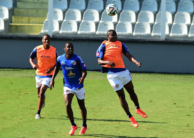 Costa Rica's Waylon Francis heads a ball next to Joel Campbell (C) and Costa Rica's defender Junior Diaz, during a training session at the Vila Belmiro Stadium, in Santos, Sao Paulo State, on July 2, 2014