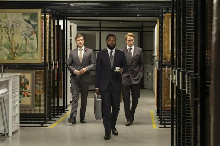 "From left, Jack Cutmore-Scott, John David Washington and Robert Pattinson in Warner Bros.' ""Tenet."" <span class=""copyright"">(Melinda Sue Gordon / Warner Bros. Pictures)</span>"