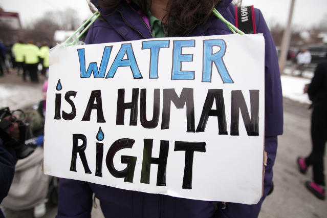 People gather in February 2016 for a mile-long march to highlight the push for clean water in Flint. (Photo: Bill Pugliano/Getty Images)